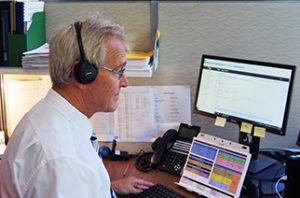 Daniel answering a call at his desk