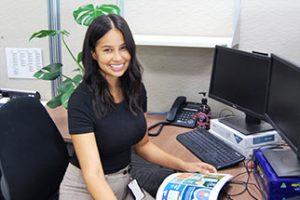 Robyn sitting at her desk