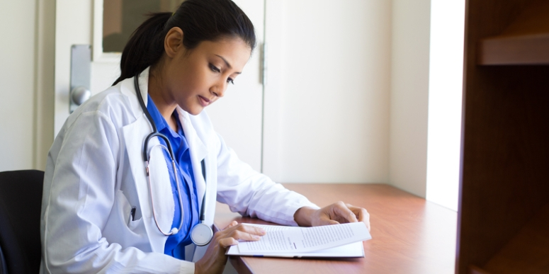 Doctor reviewing paperwork